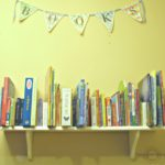Simple Bookshelf with Creative DIY Bookends. What a brilliant way to use a cheap shelf for kids books!