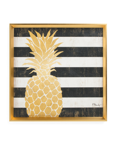 Tropical pineapple decor can be as simple as a pineapple print in a frame!!