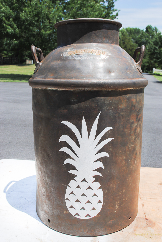 Using a Cricut Explore Air 2 to make a pineapple stencil for this milk can planter.
