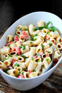 Pasta Salad is a staple for any summer picnic. This is one of the best side dishes for your next potluck.
