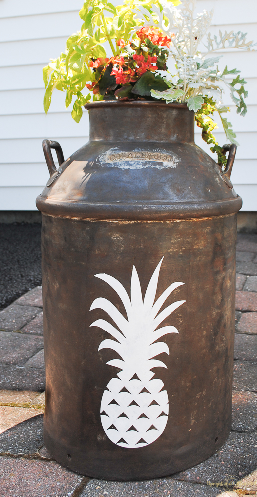 This Pineapple milk can planter brightens any outdoor space with the welcoming pineapple symbol.