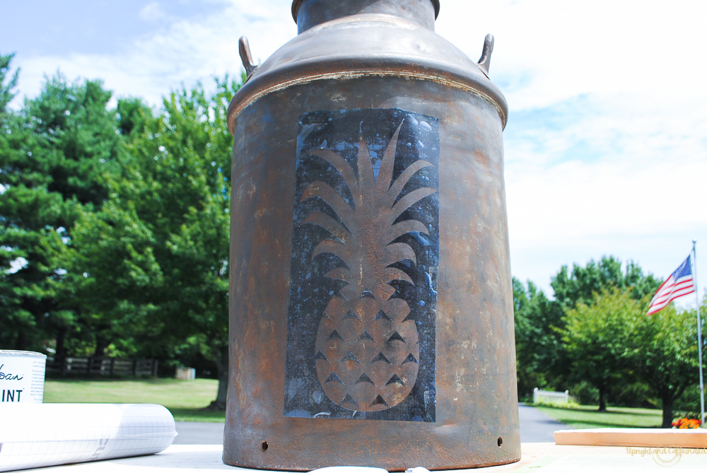 Easily update an old milk can to a pretty planter by adding a stencil.