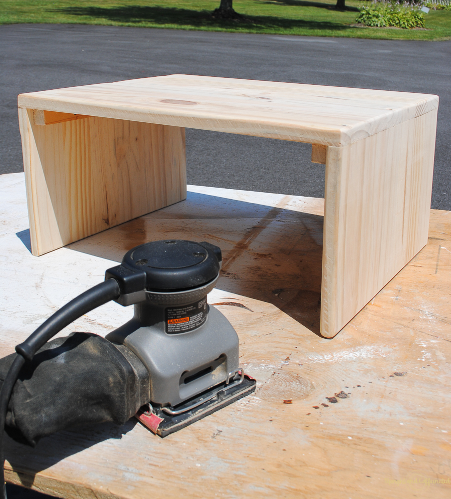 Use a sander to smooth out the wood on this DIY laptop table.