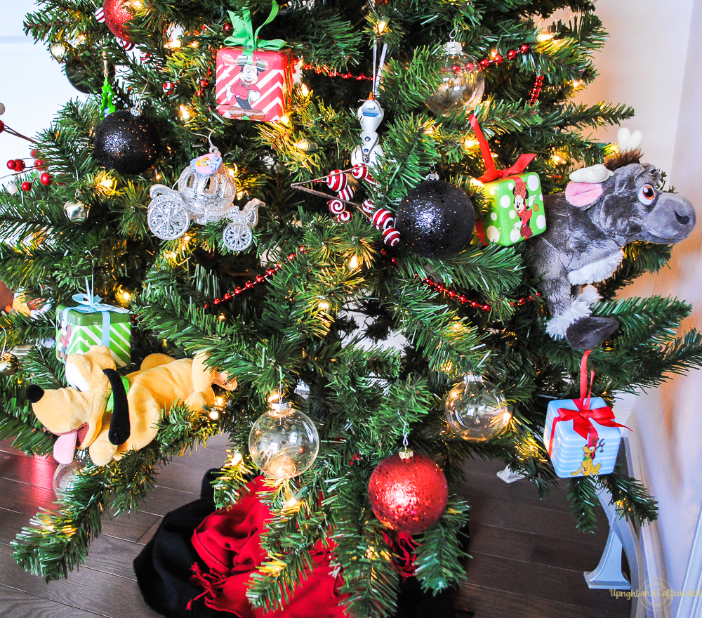 use solid colored balls and disney ornaments to make a disney themed tree
