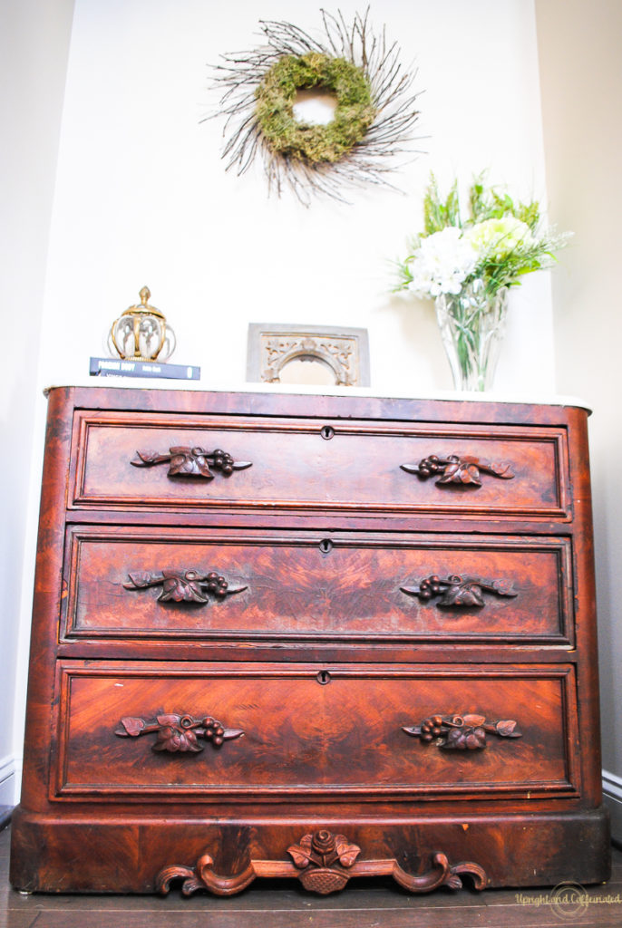 I love the way this antique dresser looks in our foyer.